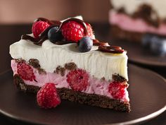 raspberry studded pink and white cream cheese cake with blueberries and chocolate - yum!