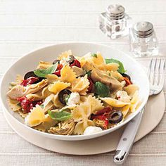 Feta and Artichoke Pasta | MyRecipes.com - Ingredients:  Salt 1 pound farfalle or other short pasta 1 cup oil-packed sun-dried tomatoes, drained (1/4 cup oil reserved), chopped 1/2 cup sliced black olives 2 ounces crumbled feta (about 1/2 cup) 1 clove garlic, minced 1 cup canned artichokes, drained, patted dry and cut into eighths 1 cup loosely packed torn fresh basil (can also use pesto as sauce)
