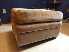 how to DIY a storage ottoman out of a regular non-storage ottoman. full tutorial.