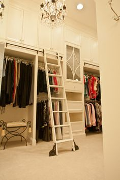 CEILING HEIGHT.  When building the house, have the ceiling height raised to highest point possible to allow built-in storage cabinets like this. Closets - traditional - Closet - Woodham's Cabinet Shop, Inc.