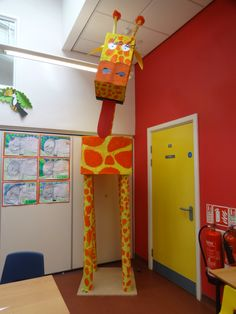 Giraffe made from carpet tubes and cardboard boxes.