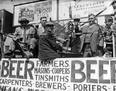 """Men ride on a float through the streets of downtown Detroit in support of the repeal of Prohibition during the city's """"Beer Parade."""" (5-14-1932)"""
