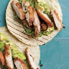 "Fried Chicken Tacos | ""Right in Tijuana's red-light district sits Kentucky Fried Buches, where cooks fry chicken necks, skin on, to fill soft corn tortillas. I can't stop eating them,"" says Andrew Zimmern. ""At home, I fry skin-on chicken thighs until they're supercrisp, then eat them with avocado-tomatillo salsa, my family's favorite."""