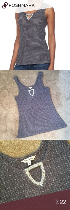 Silver Rhinestone Embellished Grey Keyhole Tank NWT Juicy Couture embellished keyhole tank. The shirt is grey with silver thread throughout, making it sparkle in the light. The material has a textured look to it and is lightweight. It has a silver rhinestone embellished keyhole detail in the front that is really pretty.   Material: 94% rayon, 5% other fibers, 1% spandex  Care: Machine wash inside out in cold water Juicy Couture Tops Tank Tops