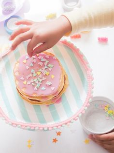Make a cake stand using a paper plate and matching paper cup