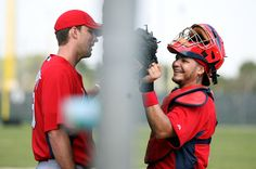 Wainwright and Molina chatting through the fence at Spring training...why it's better we got Yadi to sign a new deal <3
