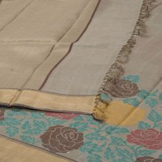 """The """"#Beige"""" #handwoven #Tussar #Silk #Sari from Sailesh Singhania is set by a gold zari with multicolour floral motifs border. An attractive gold zari adorn the beige pallu. The border is repeated on the beige blouse that completes the sari."""