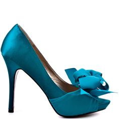 These gorgeous pumps from Luichiny are whispering your name. My Darling has a teal satin upper with a beautiful bow made of ribbon at the vamp. This peep toe style brings you a 4 1/2 inch heel and slight 1/2 inch platform to keep you dancing all night long.