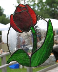 So much to LOVE about his tulip... it's plump shape extending beyond the oval and clear glass in the center with abstract lines!  By Barbara's Glassworks.