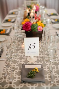 beautiful greys , yellow & blooms . love this table setting !