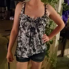 Zoey Beth  tank blouse Black with white flower design. Slants at bottom to make an off centered look Zoey Beth Tops Tank Tops
