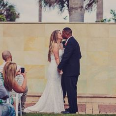 The new Mr. and Mrs. shared their first kiss as a married couple in front of family and friends. Photo Credit: Civic Photos