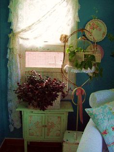 use vintage lace tablecloth for curtain..put a plant in an old birdcage..
