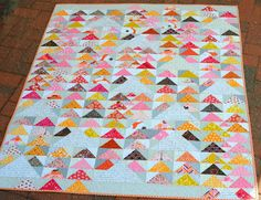 I love the pops of black!!!  Hyacinth Quilt Designs: Flying Geese... the Redbird Bee... Bloggers Quilt Festival...