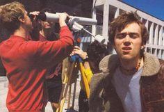 Damon Albarn. Dave is looking through Alex's telescope