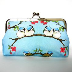 This pretty clutch features a sweet birds sitting on a flowering branch <3