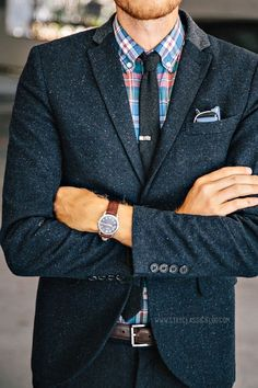 Shop this look for $147:  http://lookastic.com/men/looks/chocolate-belt-and-charcoal-tie-and-navy-blazer-and-multi-colored-longsleeve-shirt/612  — Dark Brown Leather Belt  — Charcoal Wool Tie  — Navy Wool Blazer  — Multi colored Plaid Longsleeve Shirt