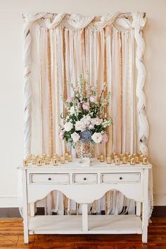 ceremony altar with large mercury glass vintage style vase, and gold mercury glass votive candles