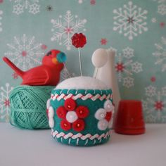 Love the aqua and red combo of this sweet pincushion. By Pine and Wine on Flickr
