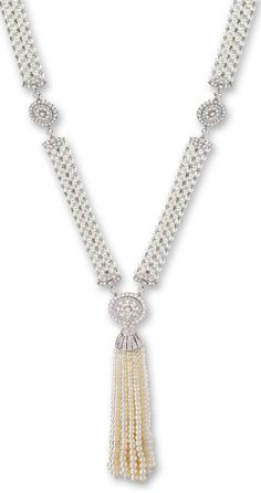 Suspending to the front with a tassel of twenty-four graduated seed pearl strands measuring approximately 2.20 to 4.40mm, supported by a seed pearl necklace, highlighted by circular-cut diamond-set floral links and clasps, the diamonds together weighing approximately 2.40 carats, mounted in platinum, length approximately 730mm, signed J.E.C. & Co. and numbered F4204, tassel detachable. Via Sotheby's.