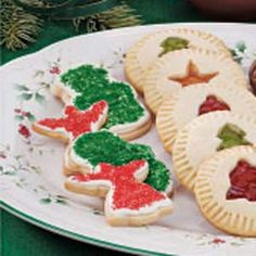 Classic Sugar Cookies Recipe -Use cookie cutters to cut seasonal shapes from a few cups of Gloria's dough. Prepared frosting and colored sugar make it a snap to decorate these classic Christmas cookies.