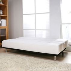 #Modern white faux leather sofa bed with buttoned seat and back design. Shiny chrome feet. Free UK delivery.