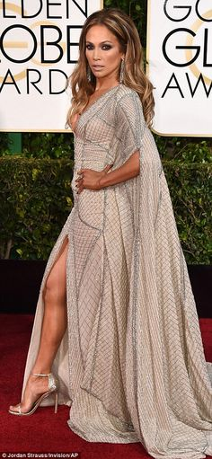 All that glitters: Jennifer Lopez made a plunging entrance in a fabulous pale caped Zuhair Murad gown