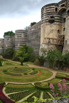 I like how the plantings pick up on the feel of the round towers.  Chateau d Angers, France