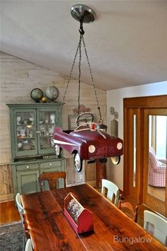 Unique pedal car chandelier made with all car parts! By Bungalow, featured on I Love That Junk  - outstanding!