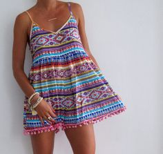 Pom Pom Jumpsuit - So obsessed with this shop. I want everything!! neon, tassels, and prints
