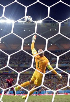 U.S. Stunned By Last-Minute Portugal Goal In World Cup Thriller - US goalkeeper Tim Howard makes a save during a Group G football match between USA and Portugal at the Amazonia Arena in Manaus during the 2014 FIFA World Cup on June 22, 2014.
