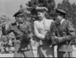Medium BTS shot of Kenny Bowers as Dutch holding baseball, Lucille Ball as Herself and Tommy Dix as Bud/Elwood C. Hooper, each young man wearing military academy uniform, hat and baseball glove.