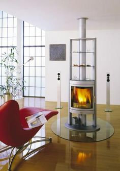 Buy Berlin Wood Stove from Wilshire Fireplace Shop; we carry Features 3 glass shelves built in the unit Rotating or non rotating. Top or rear vent unit of which are shown here.