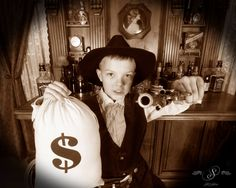 Young kid dressed as a cowboy bank robber in front of our saloon backdrop.  #oldtimephotos #oldtymephotos #oldtimephotostyle #oldtimephotostudio #reachforthesky #photography #glenwood #glenwoodsprings #glenwoodcaverns #glenwoodcavernsadventurepark #thingstodo #colorado #thingstodoincolorado #coloradovaca #coloradovacation #bankrobber