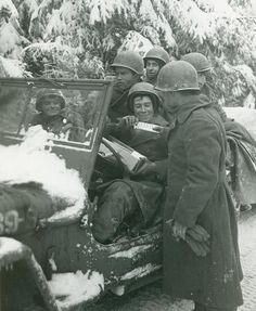 A belated Christmas gift being delivered during the late chapter of the Battle of the Bulge