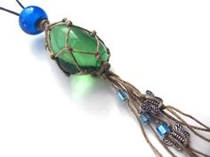 Boho macrame necklace, green andara crystal glass, netted stone, handmade, hemp macrame, with butterflies and blue glass bead, one of a kind