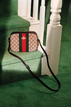 The Web and Bee shoulder bag, in signature GG motif, with dark brown leather trim and the green-red-green Web stripe embroidered with a bee from the Gucci Cruise 2016 collection by Alessandro Michele.