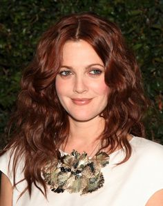 Drew Barrymore has had many hair colors, but she also looks amazing with a dark auburn shade as well. Photo: DFree / Shutterstock.com