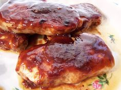 Marinated Baked Pork Chops - Dinner  Preheat oven to 350 degrees. Place pork chops in a medium baking dish, and spread with 1/2 bbq sauce. Bake pork chops 30 minutes in the preheated oven. Turn, and spread with remaining sauce. Continue baking 30 minutes.