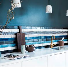 Kitchens: Blue Kitchen with Striped Tile Backsplash also White Kitchen Cabinet plus Brash Finished Sink Faucet and White Countertop