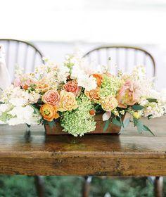 gorgeous orange-y peachy centerpiece | Sweet Tea Photography #wedding