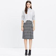 "A streamlined wrap skirt that closes with sturdy hidden snaps. We're in it for the flattering slim shape (and the unexpected plaid flannel). <ul><li>A-line skirt.</li><li>21"" long.</li><li>Wool/nylon/elastane.</li><li>Import.</li><li>Select stores.</li></ul>"