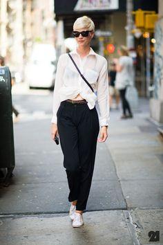 White sneakers, carrot pants, white shirt.