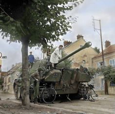 US troops and locals inspect a disabled Panzer V Pantherpossibly from the 9.Pz. Div. in the Avenue de Soissons, Château-Thierry, France. 28th August 1944.