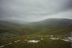 Snowy summer on Assy-Turgen mountain plateau, Kazakhstan