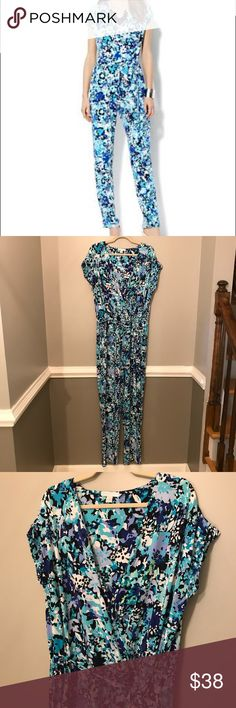 NY & Co. floral jumpsuit in shades of blue Lovely shades of blue and white floral print jumpsuit by New York & Company.  Short sleeve. Elastic waist with sash. Faux wrap top. Beautiful colors. Flattering cut. Size XL.  Great ore owned condition. No visible flaws. New York & Company Pants Jumpsuits & Rompers