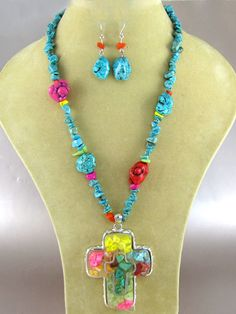 Turquoise chip stone necklace with cross pendant with multicolor details and matching fish hook earrings. Nickel and Lead Safe.  We accept PayPal!$14.95 shipped!