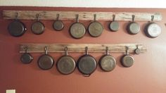 Cast iron skillet display on reclaimed barn wood.  Located in dining room.