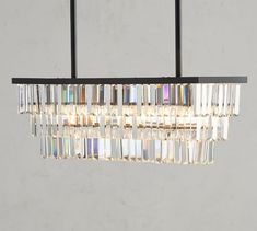 Clear faceted crystals in our Gemma Collection give a contemporary look to a classic design. They hang from smooth bronze-finished bands in our Gemma Rectangle Chandelier. Place it over a dining table, in an entryway or bedroom for lighting that s… Antler Chandelier, Globe Chandelier, Chandelier Lighting, Crystal Chandeliers, Entryway Chandelier, Dining Lighting, House Lighting, Island Lighting, Outdoor Lighting