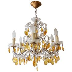 1920 French Yellow Prisms, Beaded Chandelier | From a unique collection of antique and modern chandeliers and pendants  at https://www.1stdibs.com/furniture/lighting/chandeliers-pendant-lights/